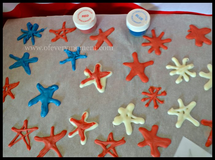 Melted candy stars need to set up before removing them from parchment paper.