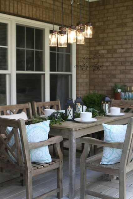 Outdoor patio area with lanterns and white dishes