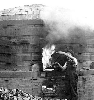 Beehive Brick and Tile kiln  Wheatly & Co Ltd, Trent Vale, Stoke-on-Trent   Baiting the hob mouthed oven with coal