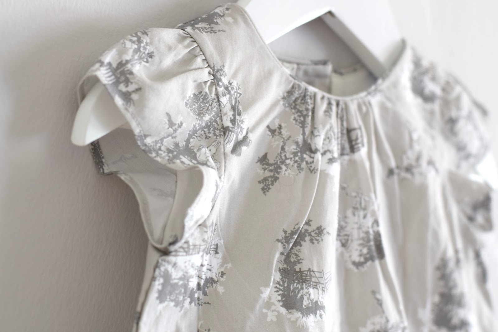 ee6106b33 My first pick was in keeping with my obsession with everything grey and  white! This adorable romper dress, which features idyllic prints of Peter  Rabbit ...