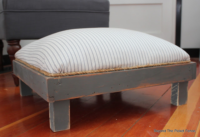 footstool, ottoman, upholstered, DIY, pillow ticking, upcycled, http://bec4-beyondthepicketfence.blogspot.com/2016/03/the-accidental-footstool.html