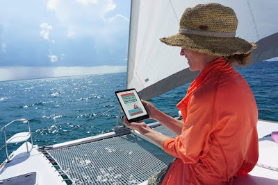 Ellen Jacobson's Operation Awesome Debut Author Spotlight and Emerging First Book -- My friend Lucy reading Murder at the Marina on her catamaran #boating #reading