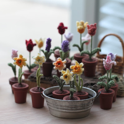 https://www.etsy.com/listing/226406338/five-miniature-crochet-flowers-tulips?ref=shop_home_active_9