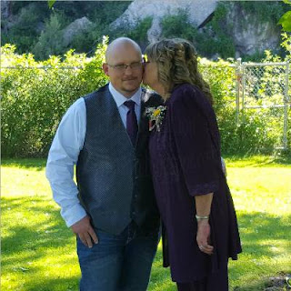 our son Randy being kissed by his mom just before his wedding
