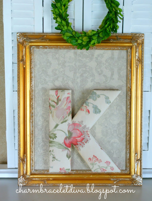 ornate vintage gilded thrift store frame and Anthropologie floral monogram letter K