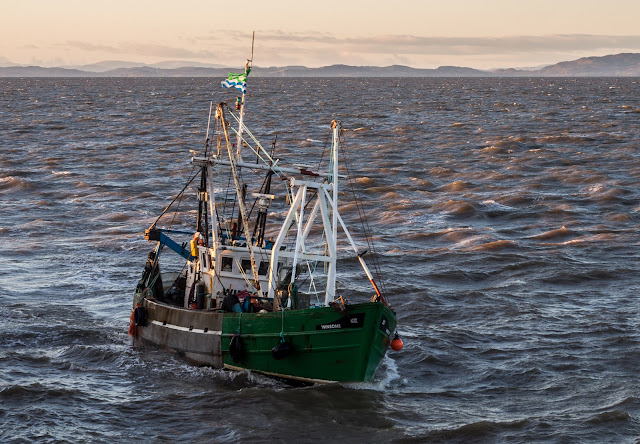 Photo of a local fishing boat returning home to Maryport
