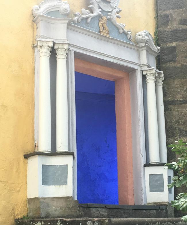 Portmeirion-Wales-doorway-with-beautiful-mediterranean-blue-inside