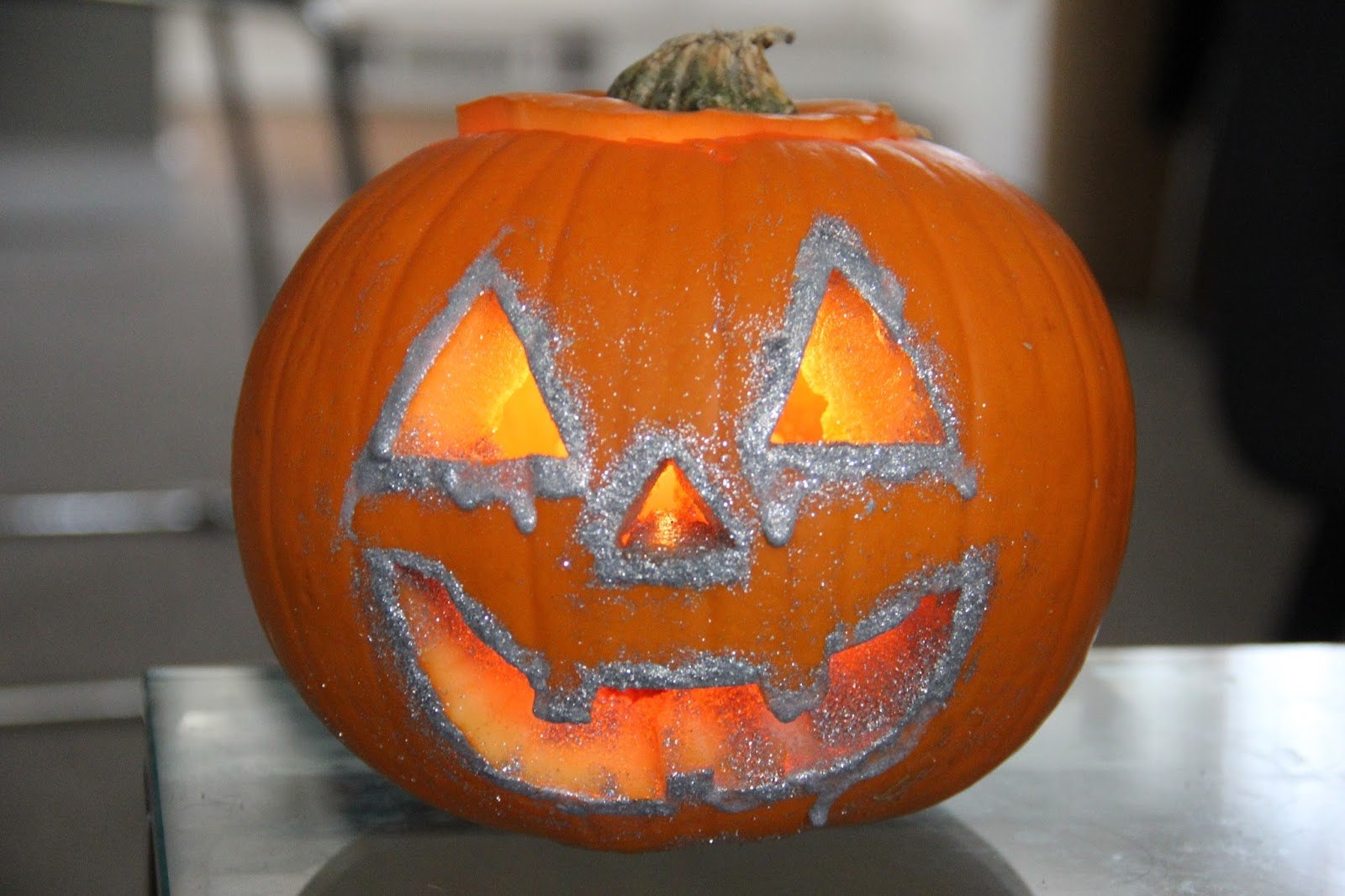 The decorated pumpkin.