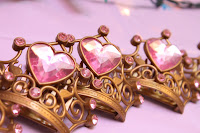 Three golden crowns with pink rhinestones at a birthday party
