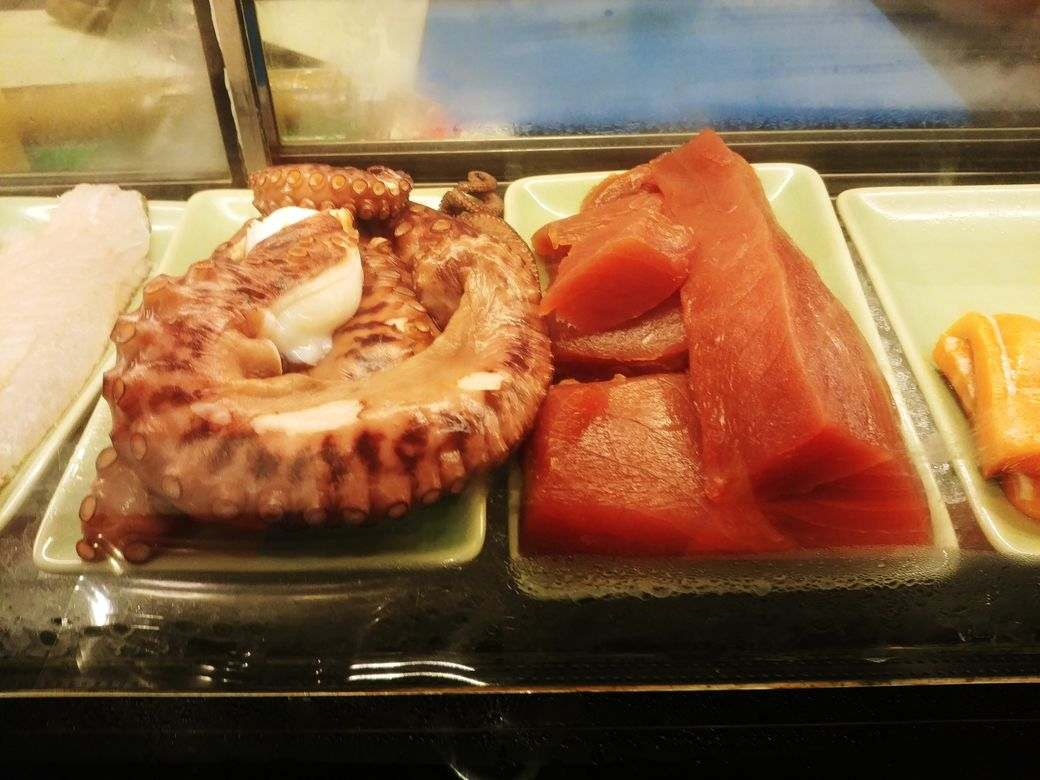 Fresh octopus and salmon at the Japanese station of The Grand Kitchen
