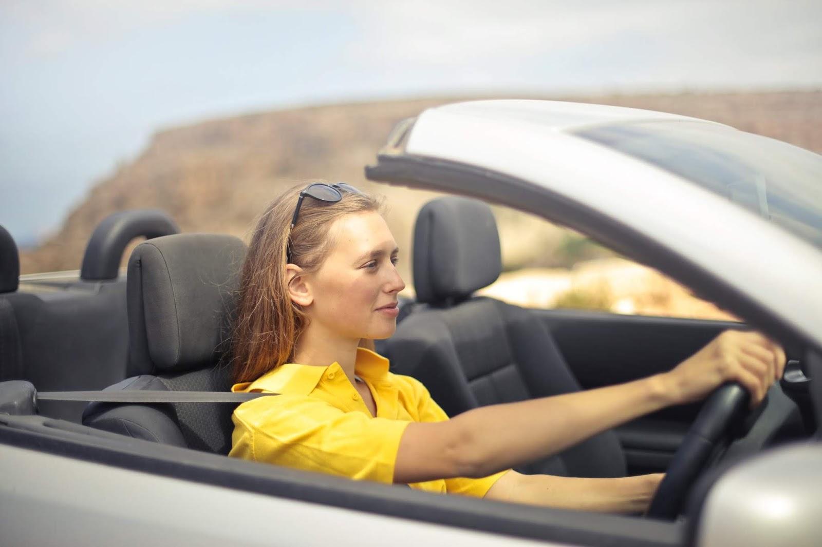 woman driving a sports car