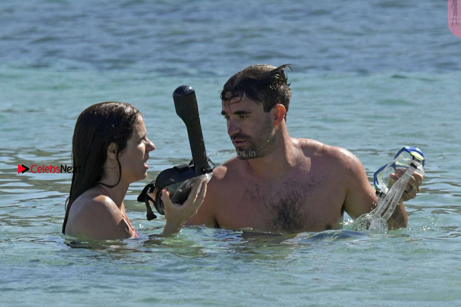 Katerina Stefanidi in orange wet Bikini withj Boyfriend Sex and fun boobs ass on the beach in Mykonos