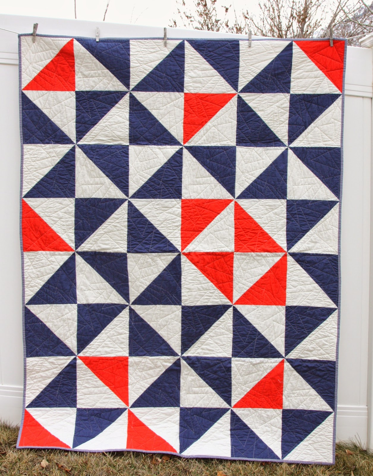 This image has an empty alt attribute; its file name is Modern-kona-solids-half-square-triangle-quilt.JPG