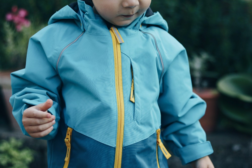close-up-of-torso-of-toddler-boy-wearing-blue-coat