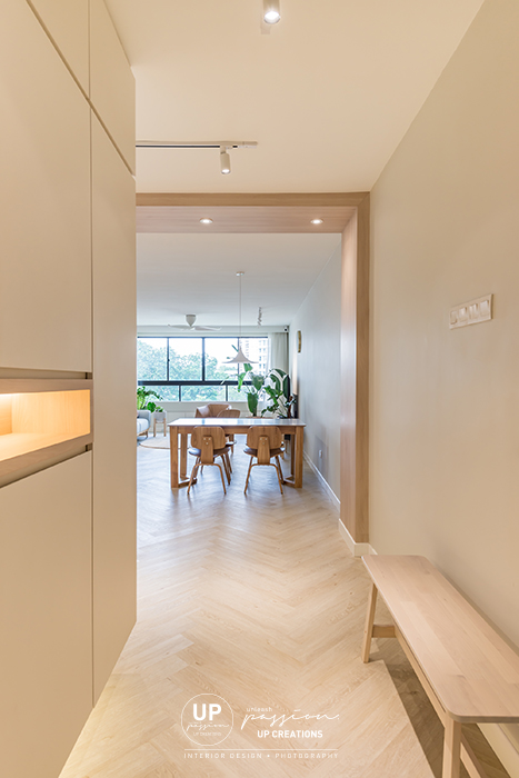 Mont Kiara Pines condo entrance corridor with a minimalist cabinet design and wood texture arch for a welcoming ambient