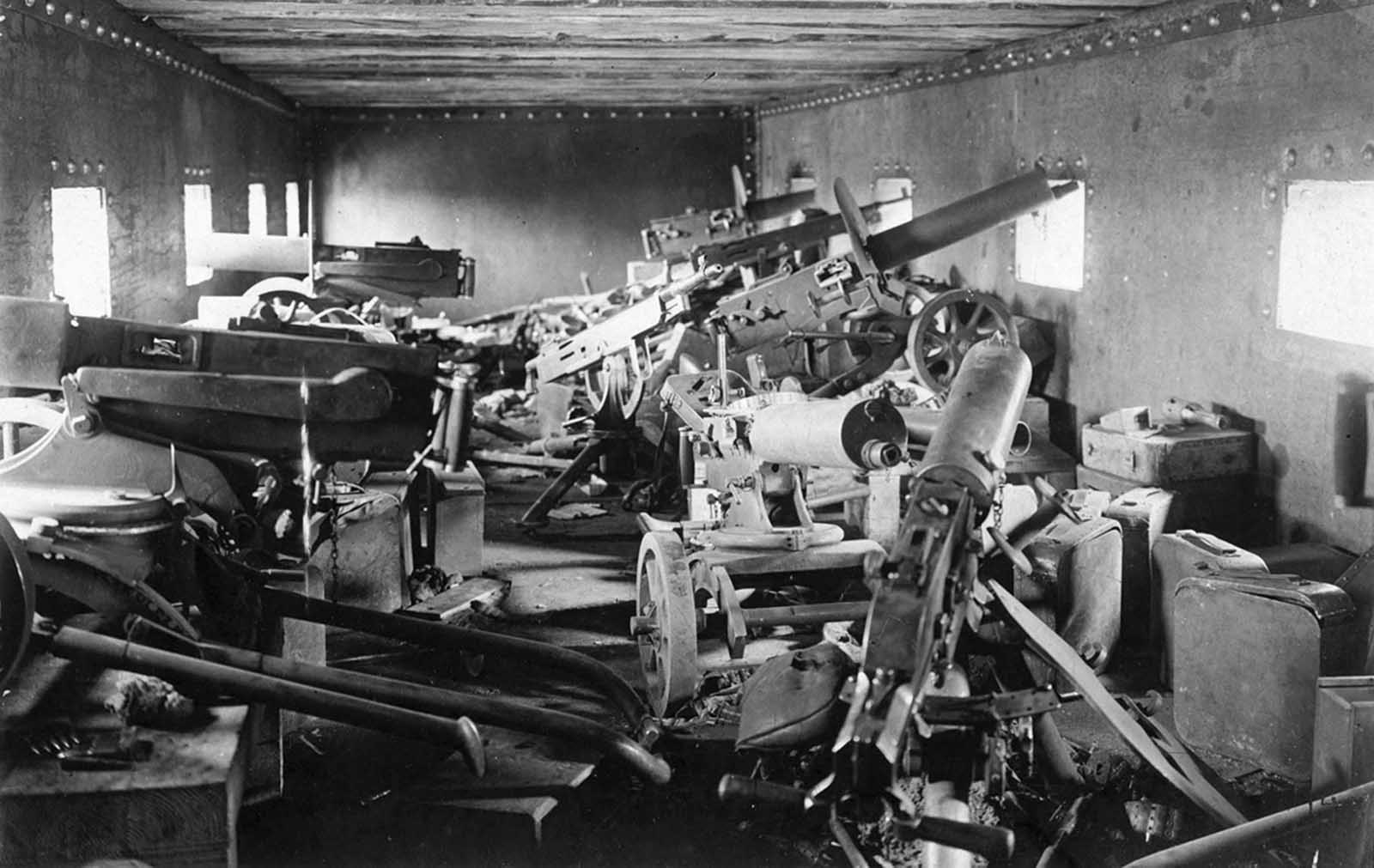 The interior of an armored train car, Chaplino, Dnipropetrovs'ka oblast, Ukraine, in the spring of 1918. At least nine heavy machine guns are visible, as well as many ammunition cases.