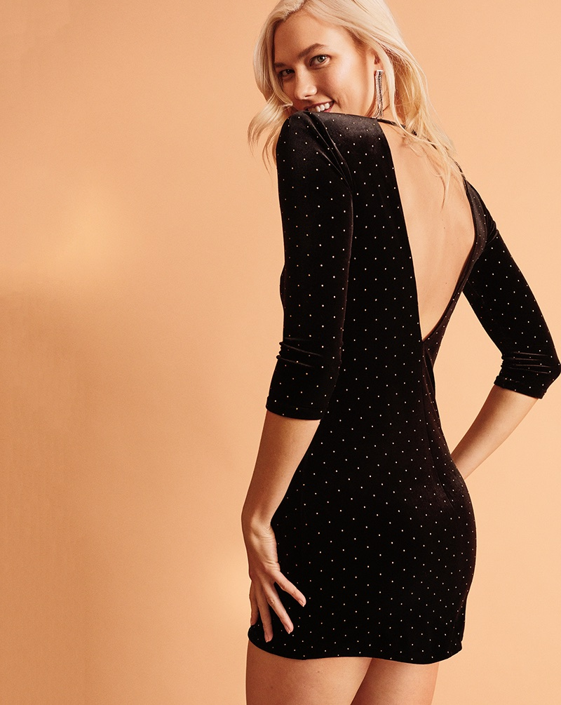 Karlie Kloss models Express Studded Velvet Sheath Dress