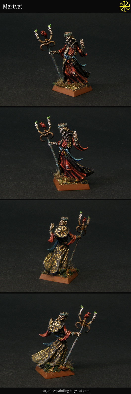 A single Liche miniature from Otherworld Miniatures on a square base, adapted to be used as a necromancer in WFB or AoS. He has a mix of red robes and black ones with yellow, freehanded patterns.