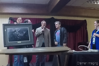 Audrey displaying Cramer Imaging's gift to Paul Michael Glaser at the Snake River Comic Con 2017