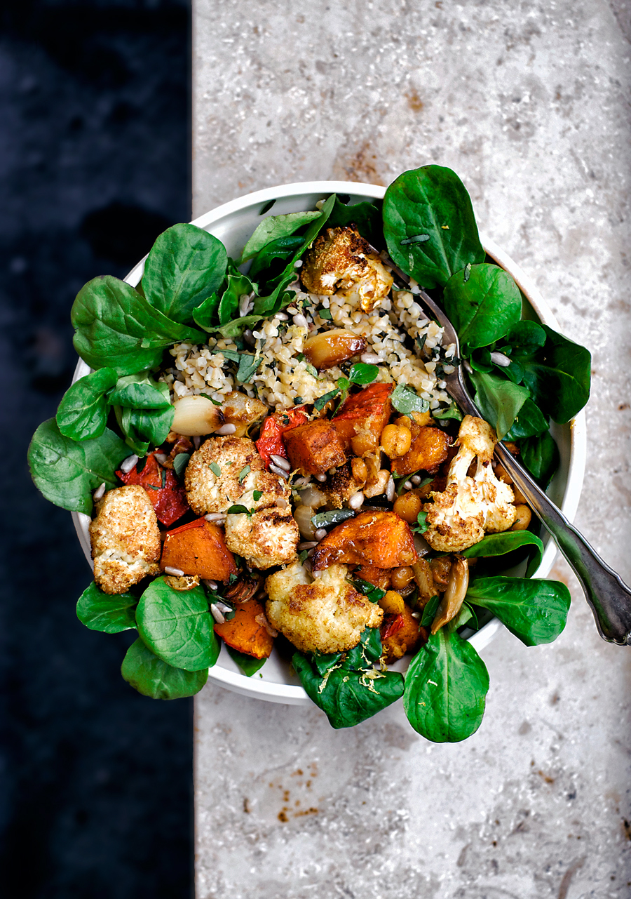 Vegan cauliflower grain bowls with pumpkin, garlic, bulgur, and plenty of herbs. Winter in a bowl and using all local ingredients, this is a budget friendly weeknight dinner or lunch and so good.