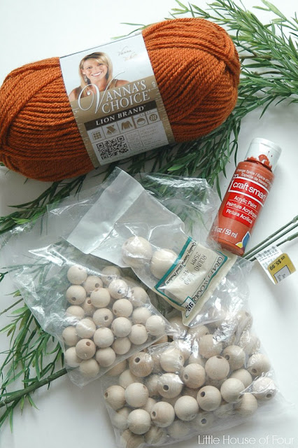 Supplies to make beaded wooden carrots