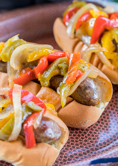 Slow Cooker Beer Brats - perfect tailgating food! Just toss everything in the slow cooker and let it work its magic. Can serve out of the slow cooker too! SO easy and the brats taste amazing!! Brats, beer, onion, bell peppers, salt, pepper, Worcestershire and garlic. A real crowd pleaser!