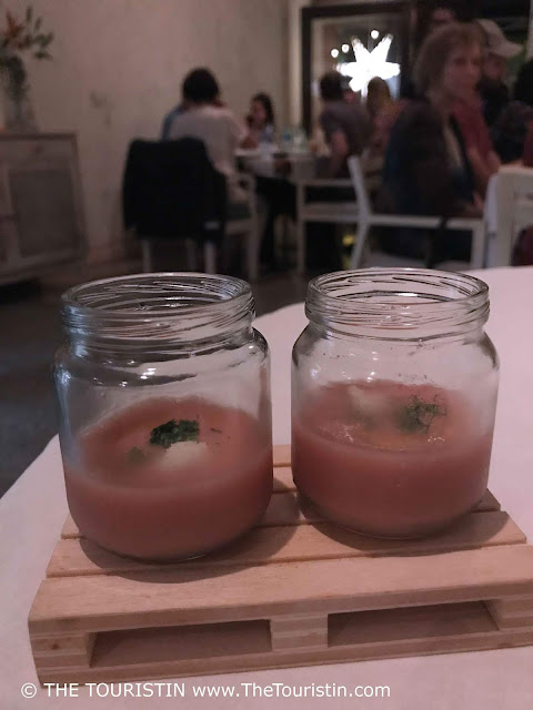 Gazpacho served in small jars on miniature wooden planks at restaurant Otramanera in Havana in Cuba