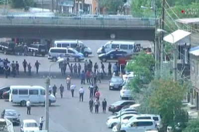 People can be seen on the streets during report of an attempted coup in Armenia