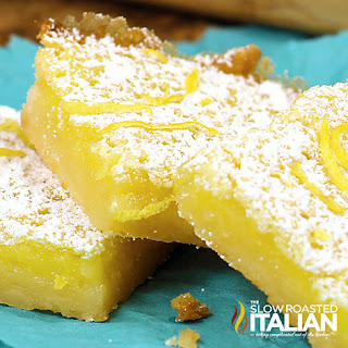 yellow cookie bars dusted with powdered sugar