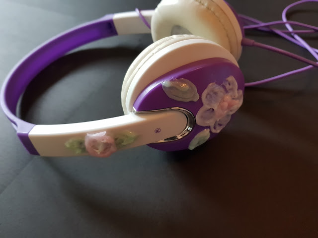 Purple and white headphones decorated with flowers created using Gel-a-Peel