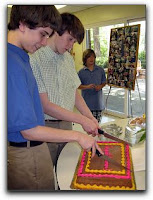 2012 high school graduates cutting their cake
