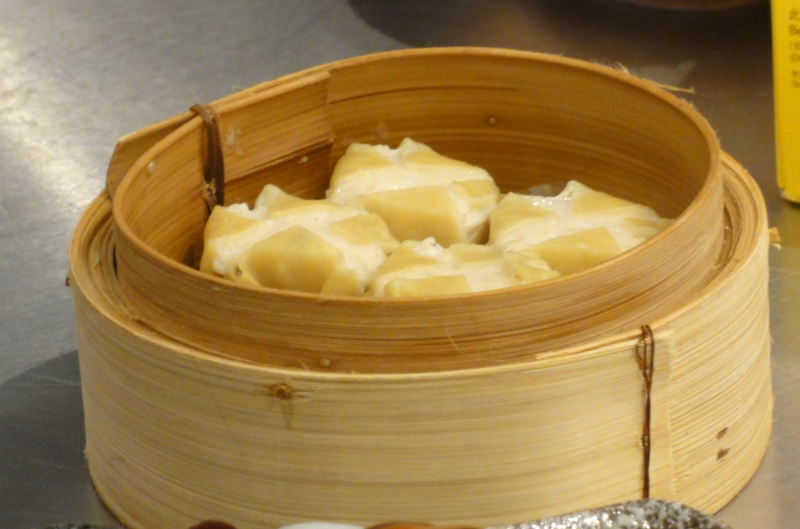 chicken sui mai in a bamboo steamer basket
