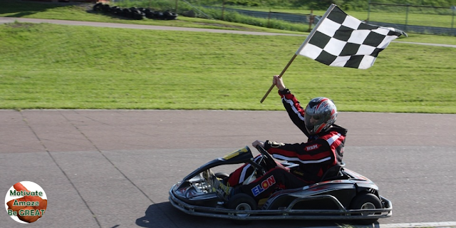 "Image of a kart finishing a race with the finish flag, featured in the article:""How To Set Goals For Yourself And Achieve Them"""
