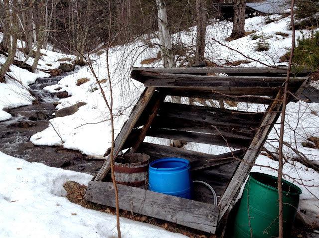 brook, snow, and water barrels