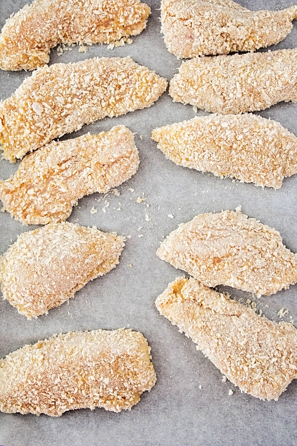 These freezer-friendly panko chicken strips are crispy and delicious, and so easy to make. Make a big batch to have on hand  for an easy meal on a busy night!
