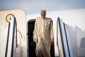 Buhari says 'I am fit', challenges reporter to a wrestling competition