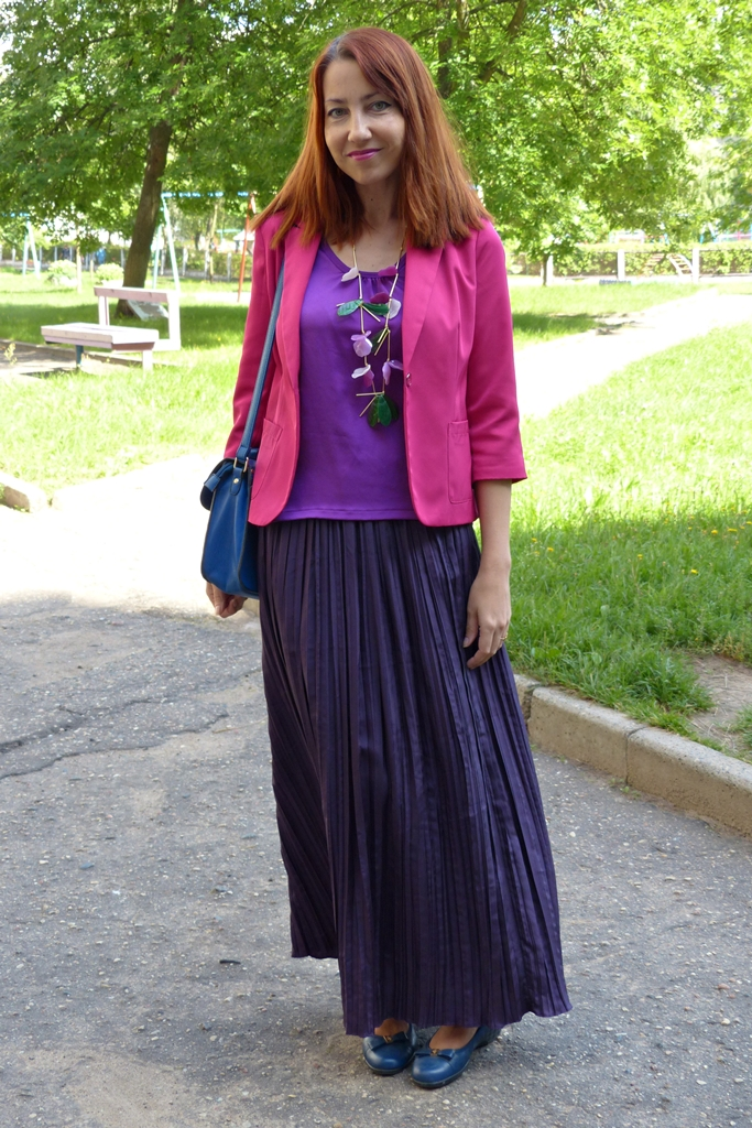 Pleated silk maxi skirt worn with jacket