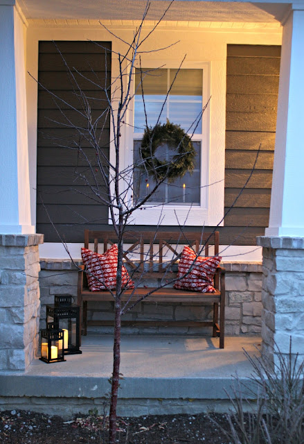 Simple wood bench and lanterns on porch