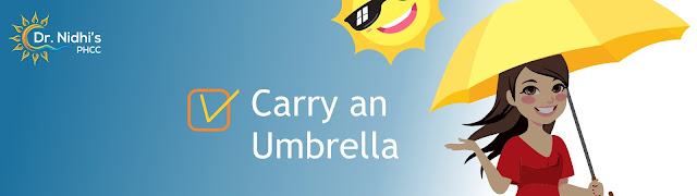A girl carrying an umbrella