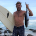 A SURFER GRABS A TUNA WITH HIS BARE HANDS