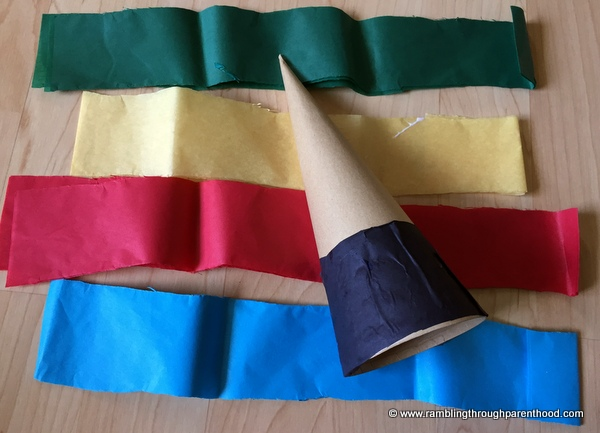 Layering tissue paper on the cone to create the Olympics inspired piece