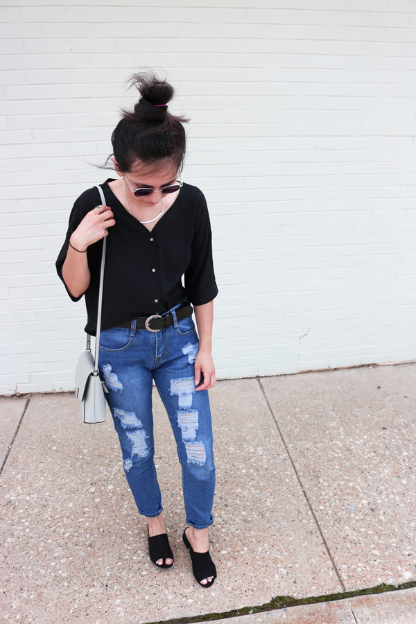 Ripped blue jeans, black sandals, vintage belt, black shirt