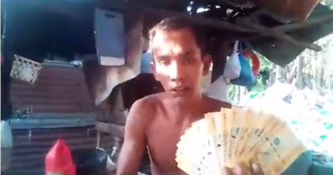 Video of man holding the money remitted by his OFW wife goes viral