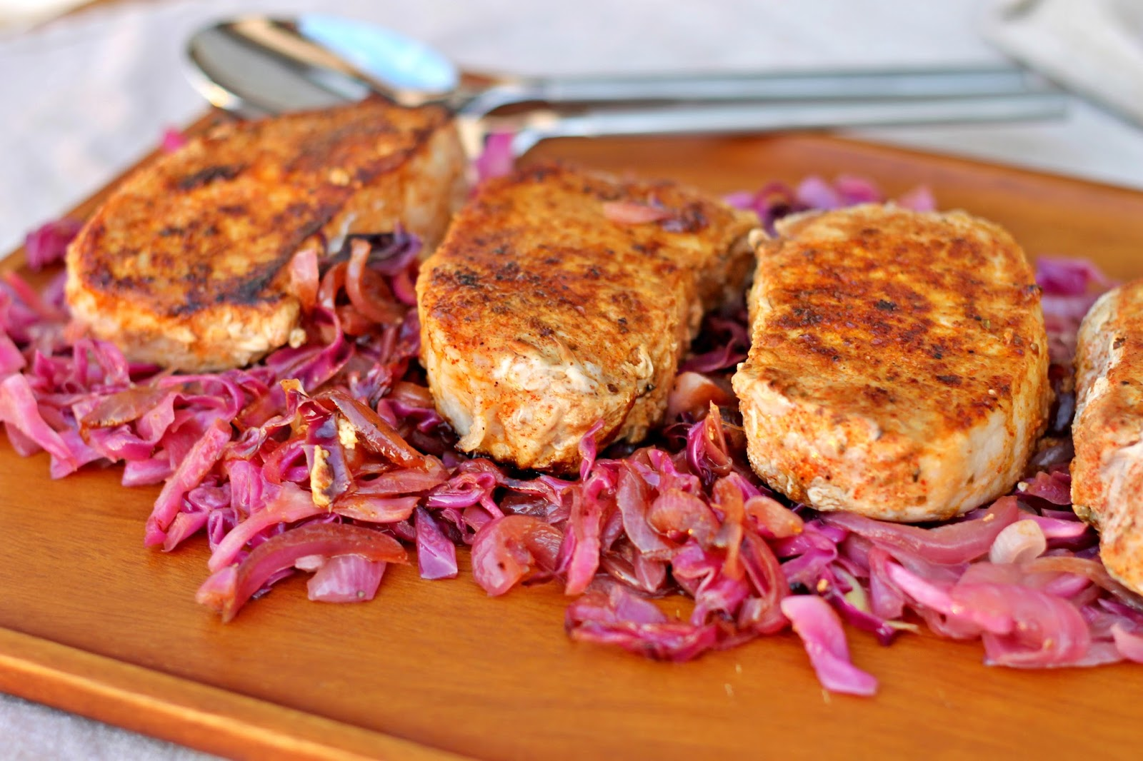 Paprika Pork Chops over Cabbage & Onions