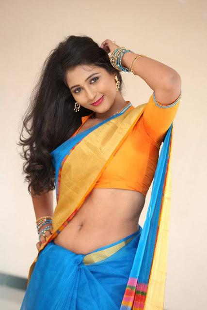 Teja Reddy Photo Shoot Stills In Blue Saree With Golden Yellow Border
