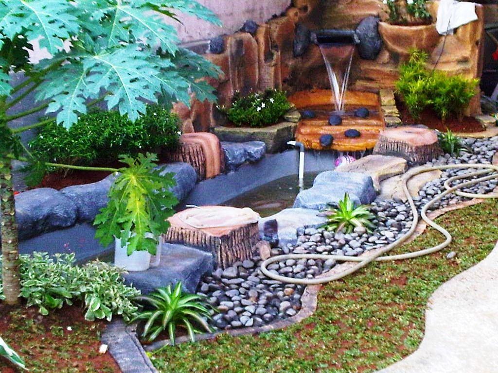 desain taman minimalis dengan kolam ikan sederhana modern09