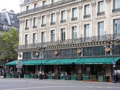 """Place de l'Opera, Cafe de la Paix, Paris"" by Britchi Mirela - Own work. Licensed under CC BY-SA 3.0 via Wikimedia Commons - https://commons.wikimedia.org/wiki/File:Place_de_l%27Opera,_Cafe_de_la_Paix,_Paris.jpg#/media/File:Place_de_l%27Opera,_Cafe_de_la_Paix,_Paris.jpg"