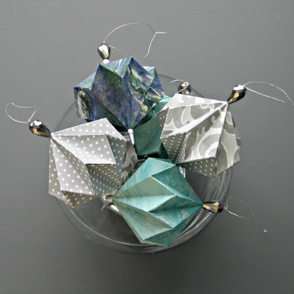 Geo Ball Origami Ornaments in shades of blue and gray with beaded tops