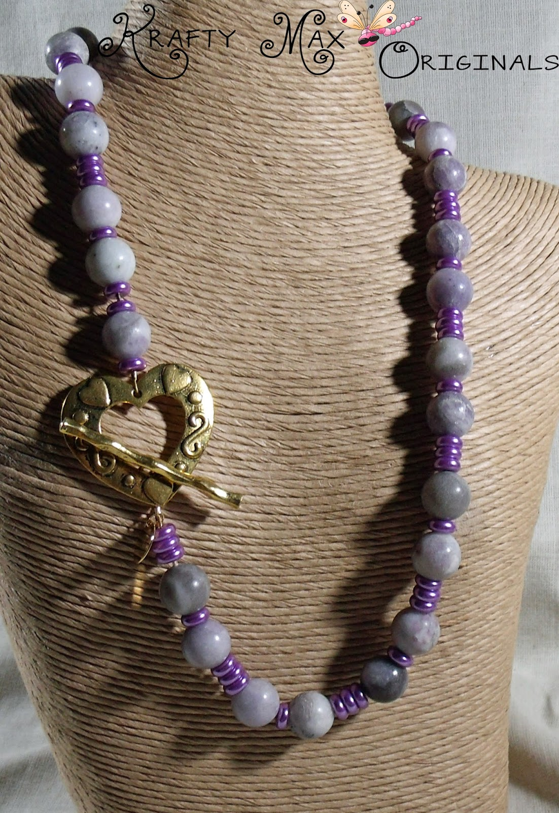 http://www.artfire.com/ext/shop/product_view/KraftyMax/9635829/purple_gemstone_with_purple_glass_pearls_fun_and_flashy_necklace_set/handmade/jewelry/sets/glass