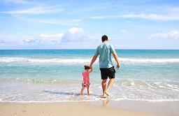 dad and child on beach